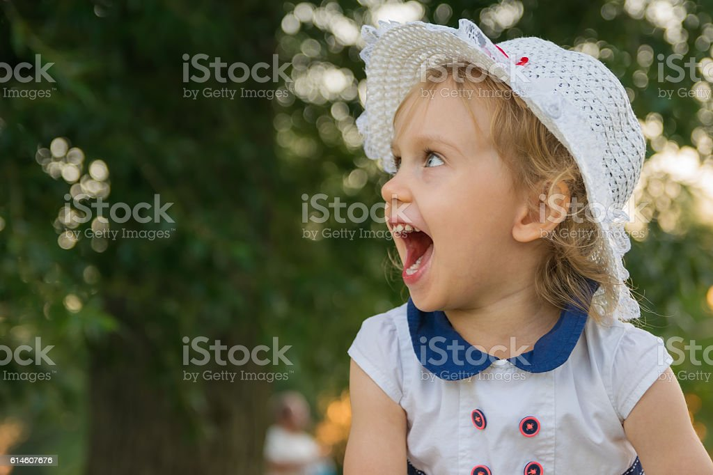 happy cheerful girl in hat stock photo