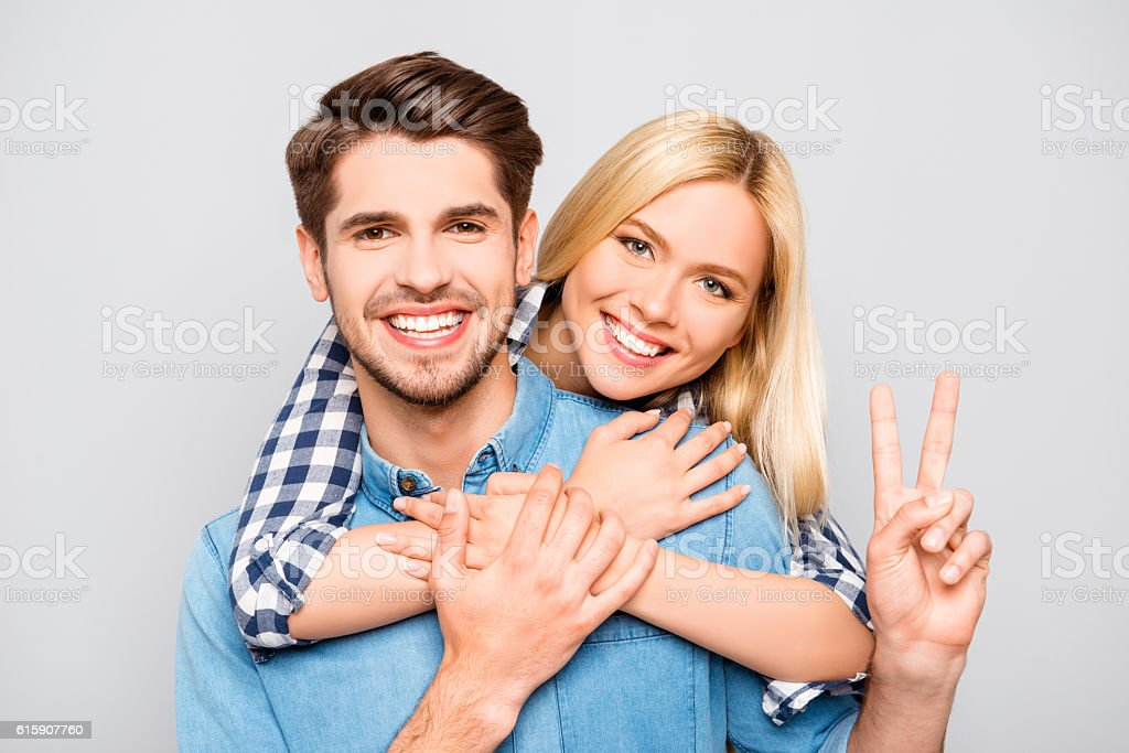Happy cheerful man carrying his girlfriend on the back stock photo