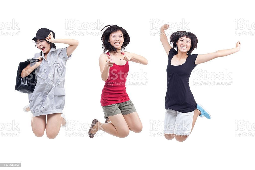 Happy, cheerful, playful youths jumping for joy royalty-free stock photo