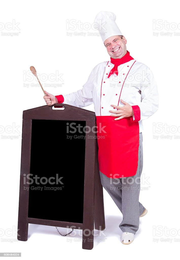 happy chef standing with an blank menu stock photo