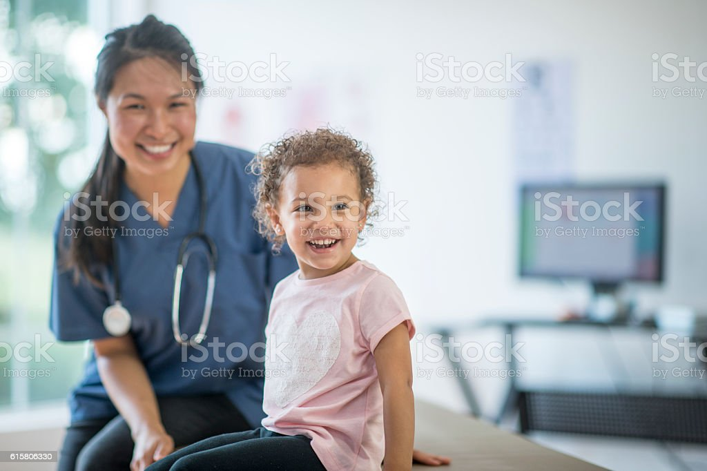 Happy Child at a Doctors Appointment stock photo