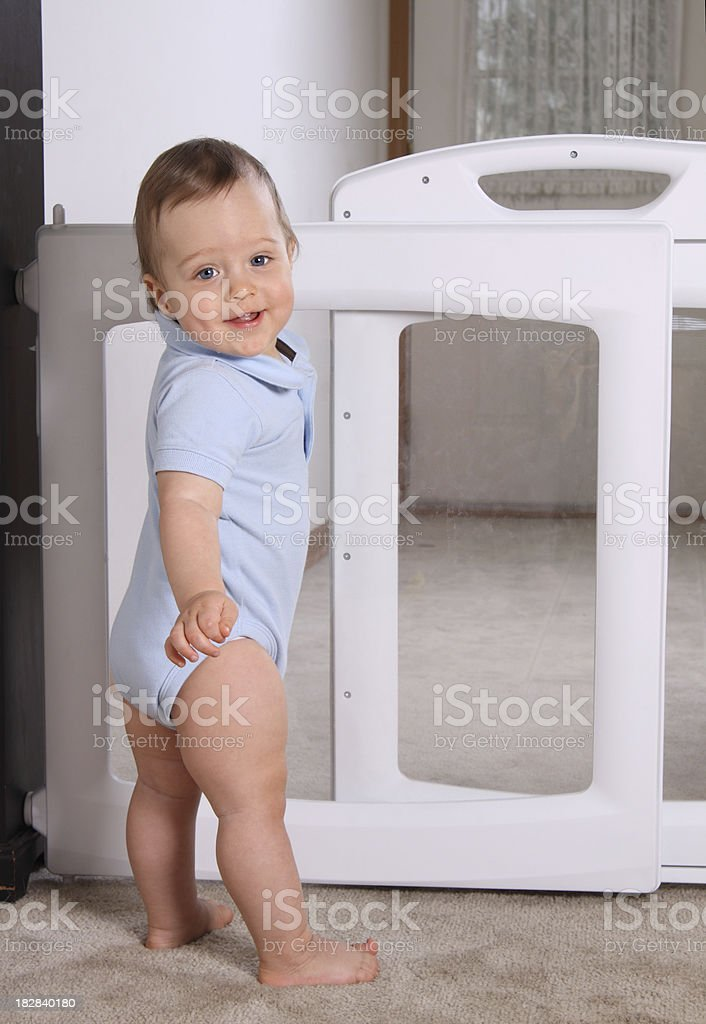Happy Child at Baby Gate stock photo