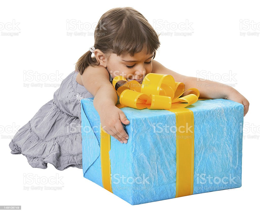 Happy child embraces large birthday gift royalty-free stock photo