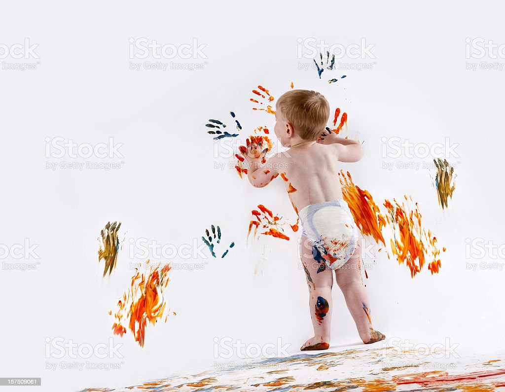 Happy Child Fingerpainting stock photo