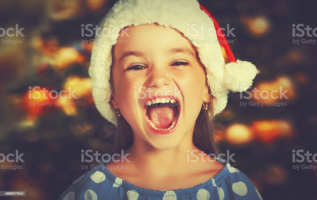 happy child girl in a Christmas hat stock photo