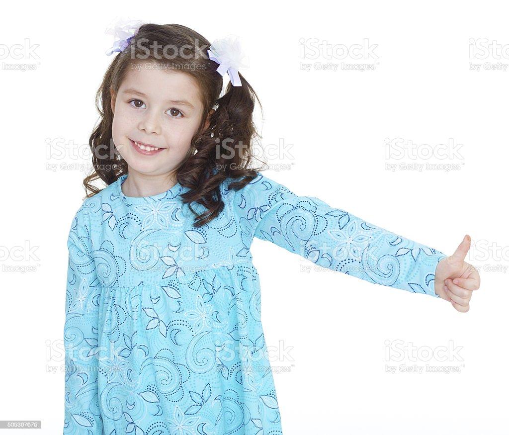 Fille enfant heureux avec mains pouce levé. photo libre de droits