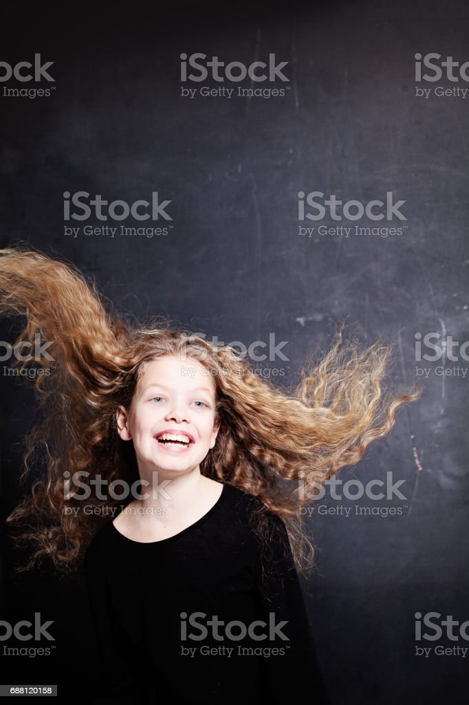 Happy Child Girl with Long Curly Hair stock photo