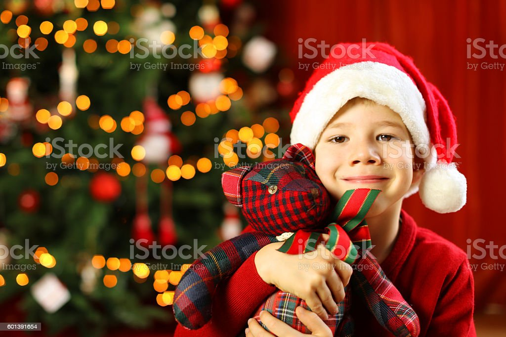 Happy Child Holding Christmas Teddy Bear stock photo