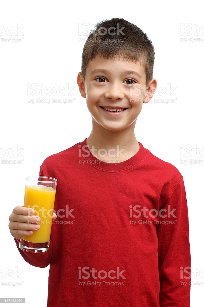 Happy child holds glass of juice royalty-free stock photo