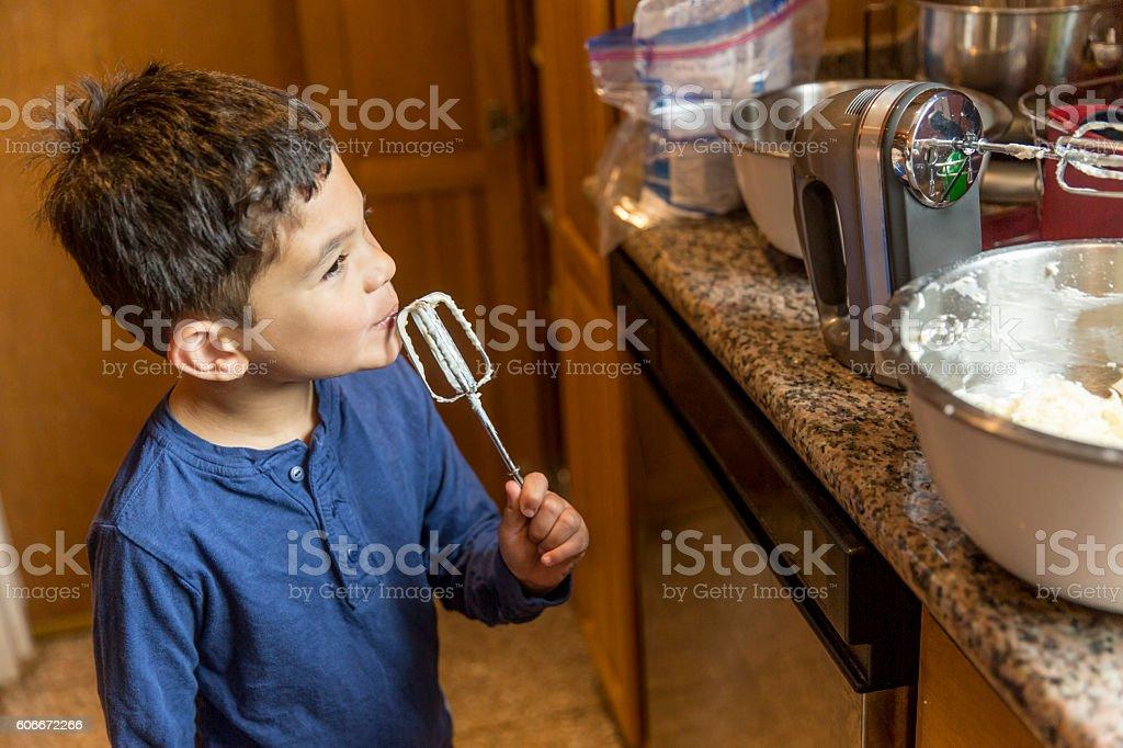Happy Child Making a Cake stock photo