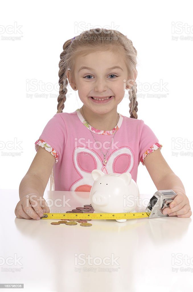 Happy child measuring savings concept royalty-free stock photo