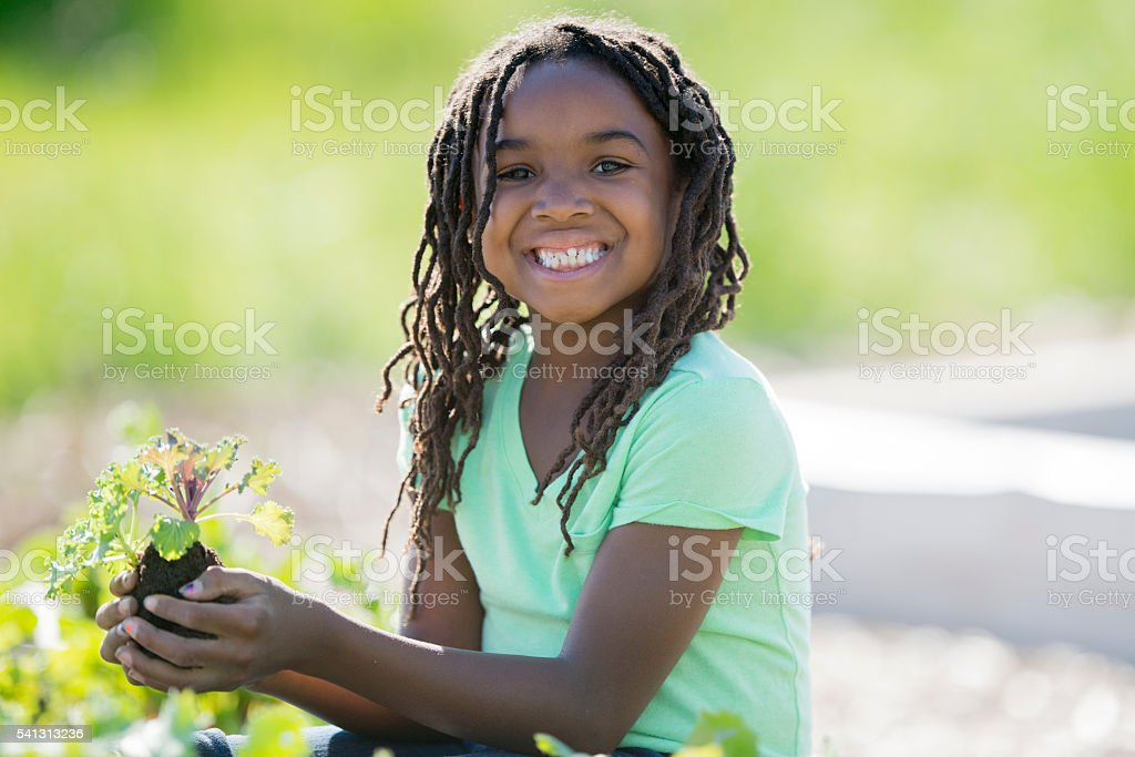 Happy Child Planting a Garden stock photo