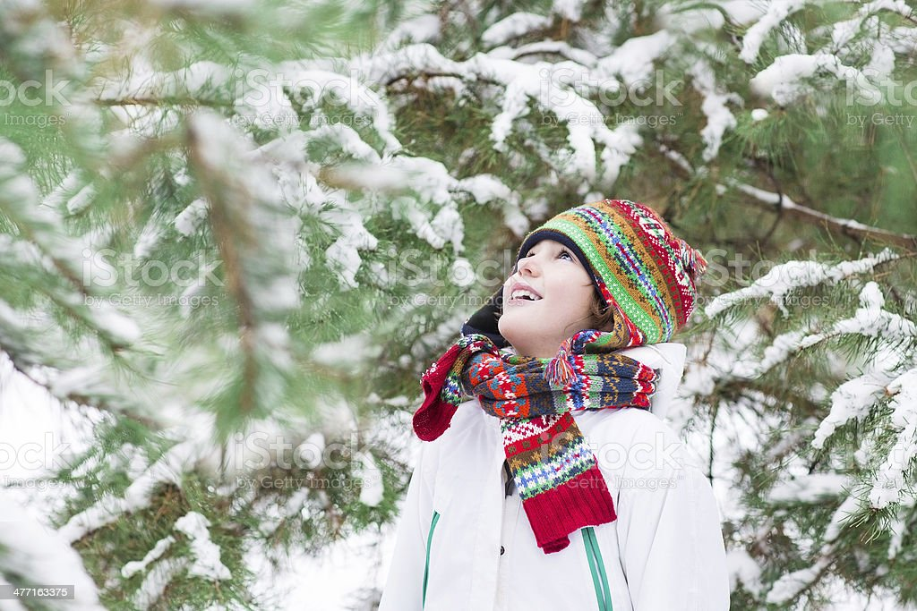 Happy child playing in a snowy forest royalty-free stock photo