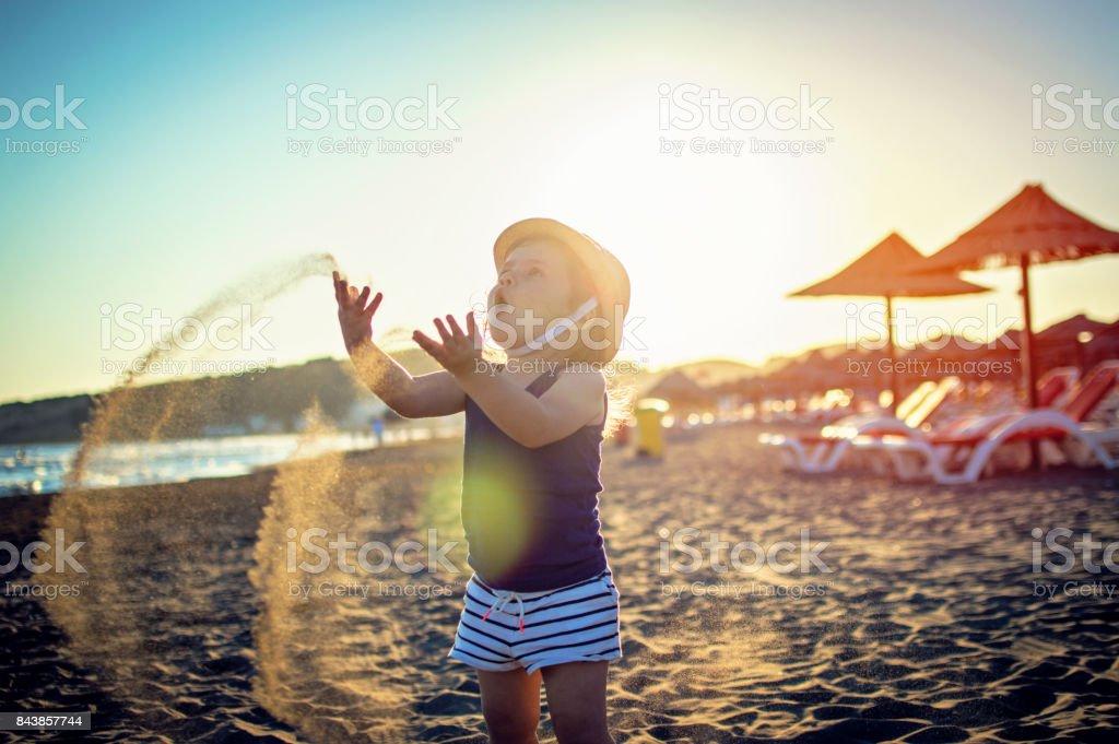 Happy child playing with sand sea beach BEAUTIFUL stock photo