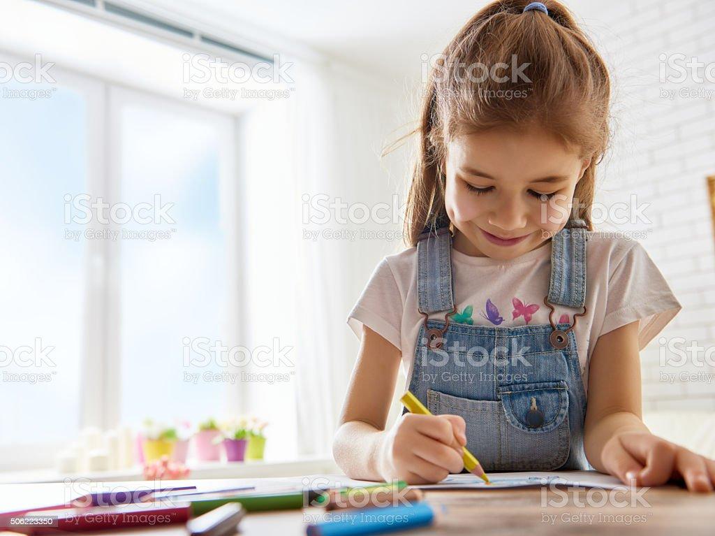 Happy child plays stock photo