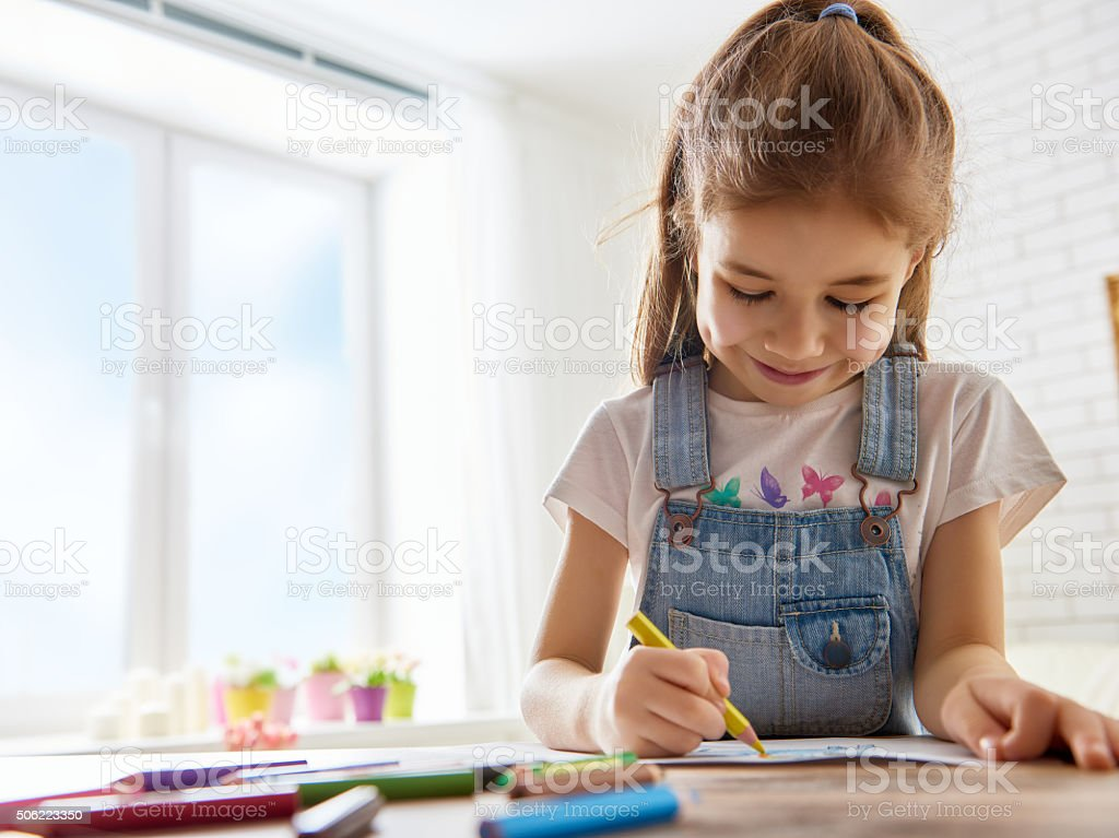 Happy child plays stock photo