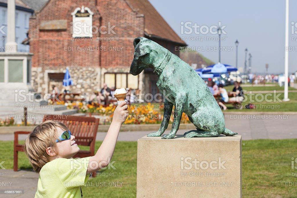 happy child with icecream in Aldeburgh stock photo