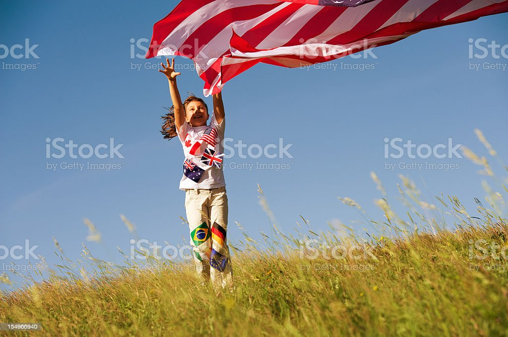 Happy child with large American Flag royalty-free stock photo