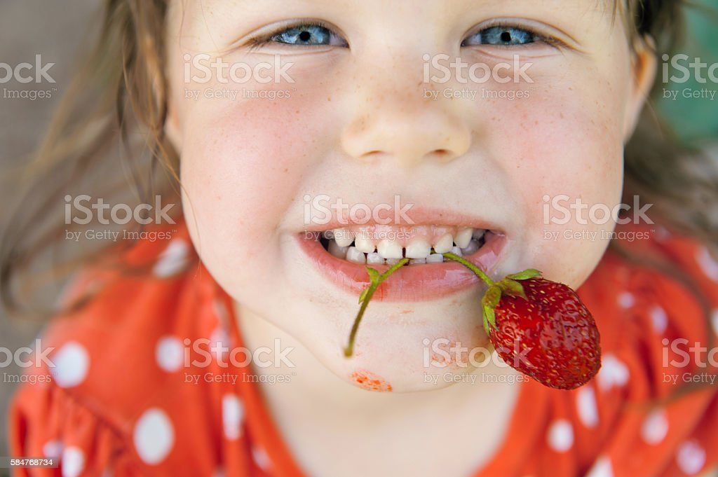 Happy child with red currants stock photo