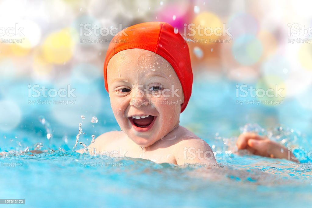 happy child with swimming pool cap in water royalty-free stock photo