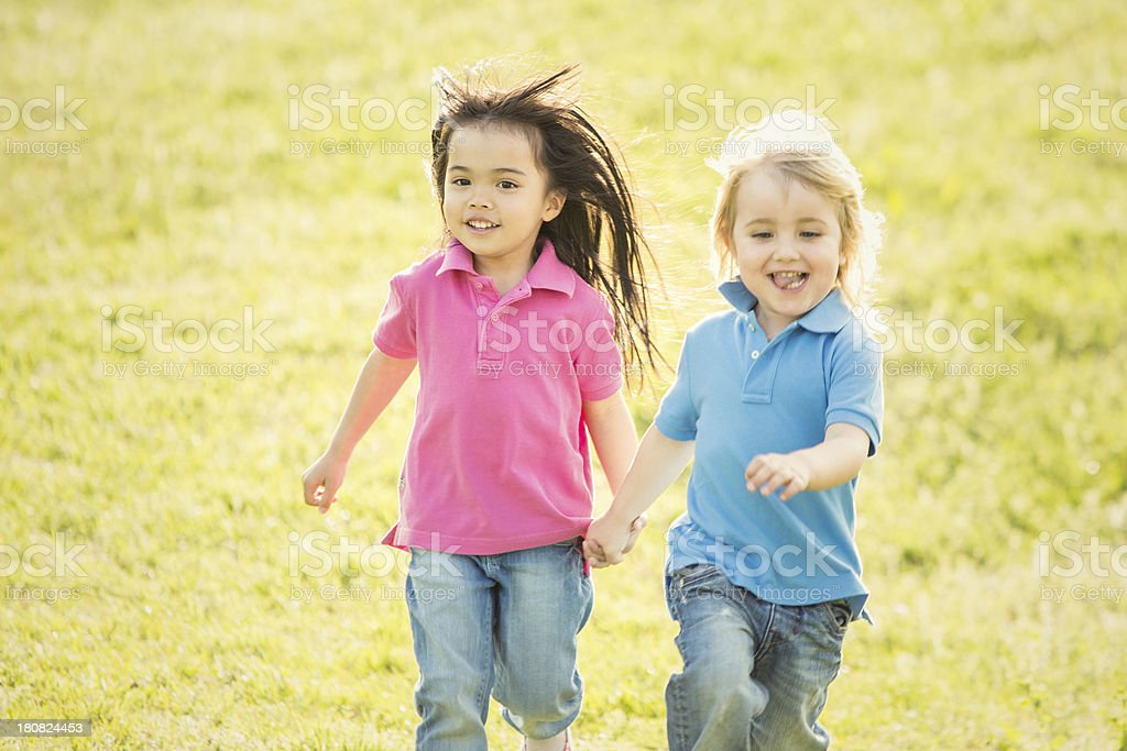 happy children are playing in the park stock photo