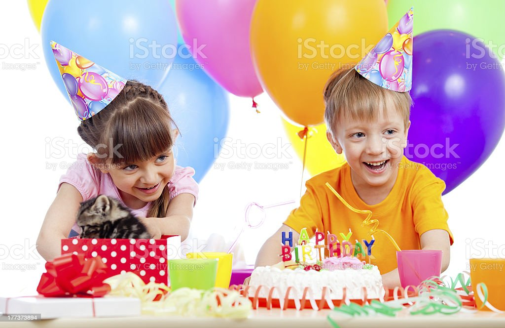 happy children celebrating birthday party with opening gift box royalty-free stock photo