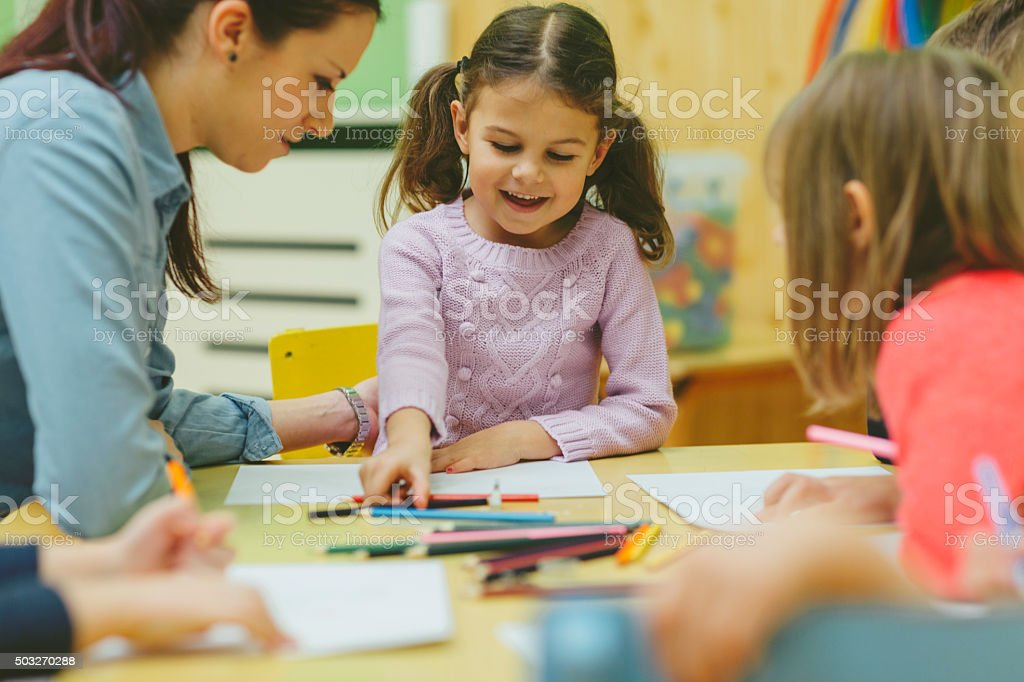 Happy Children Coloring and Sketching. stock photo