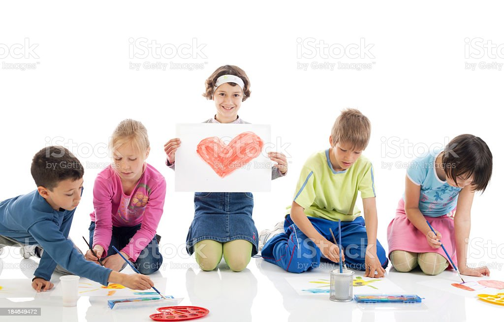 Happy children drawing. Girl showing her painted heart. royalty-free stock photo