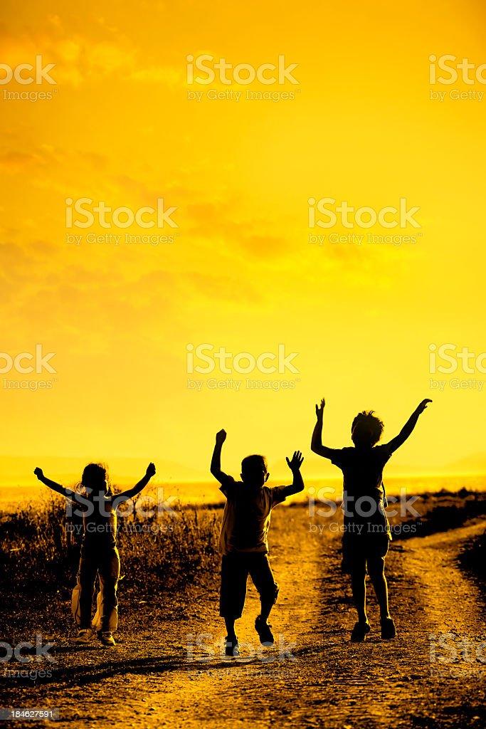 happy children during sunset stock photo