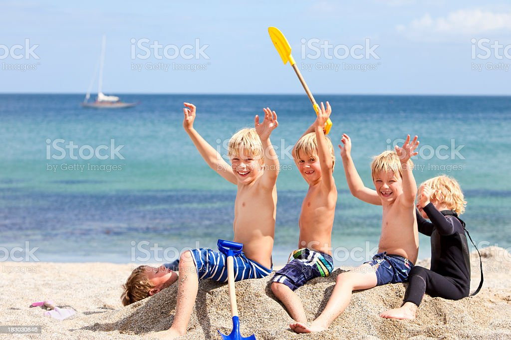 happy children having fun together at the beach on holiday stock photo