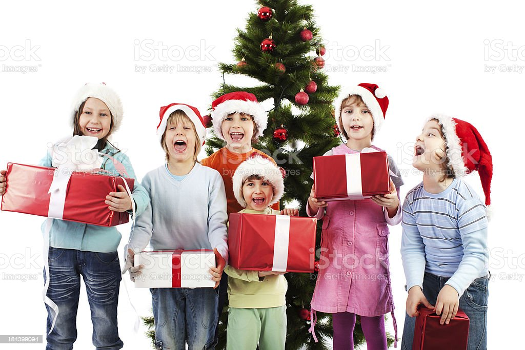 Happy children holding Christmas presents. royalty-free stock photo