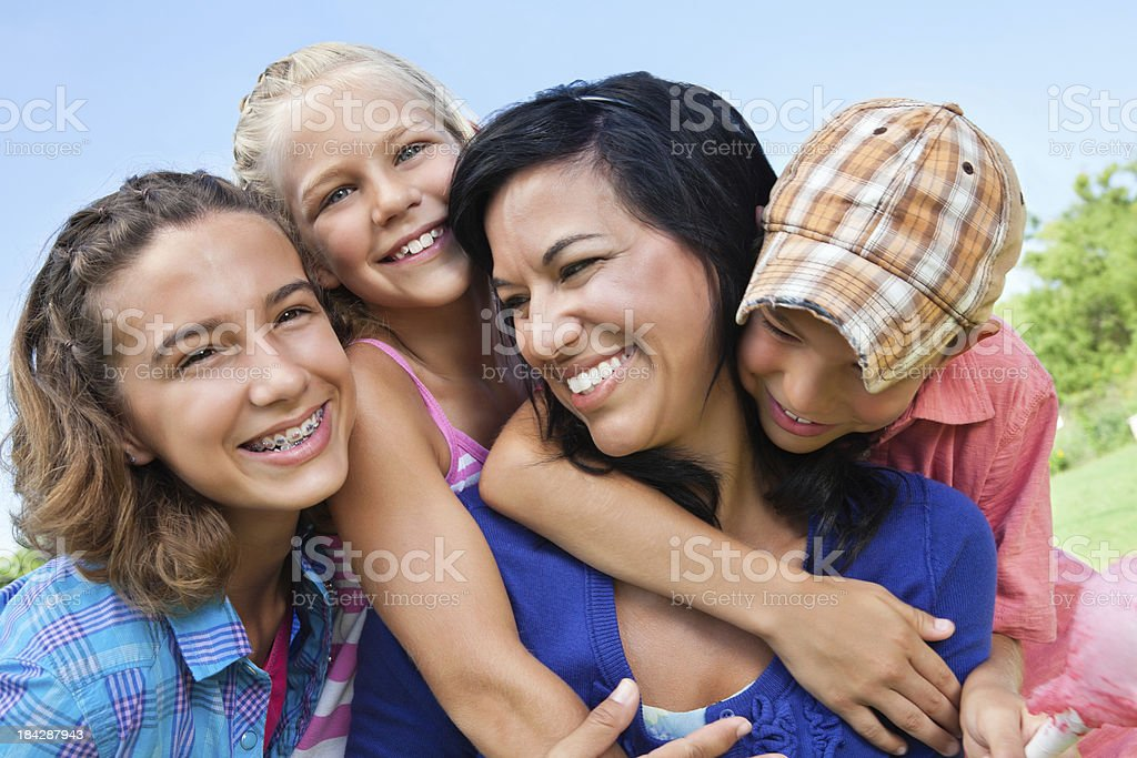 Happy Children Hugging Their Mother royalty-free stock photo
