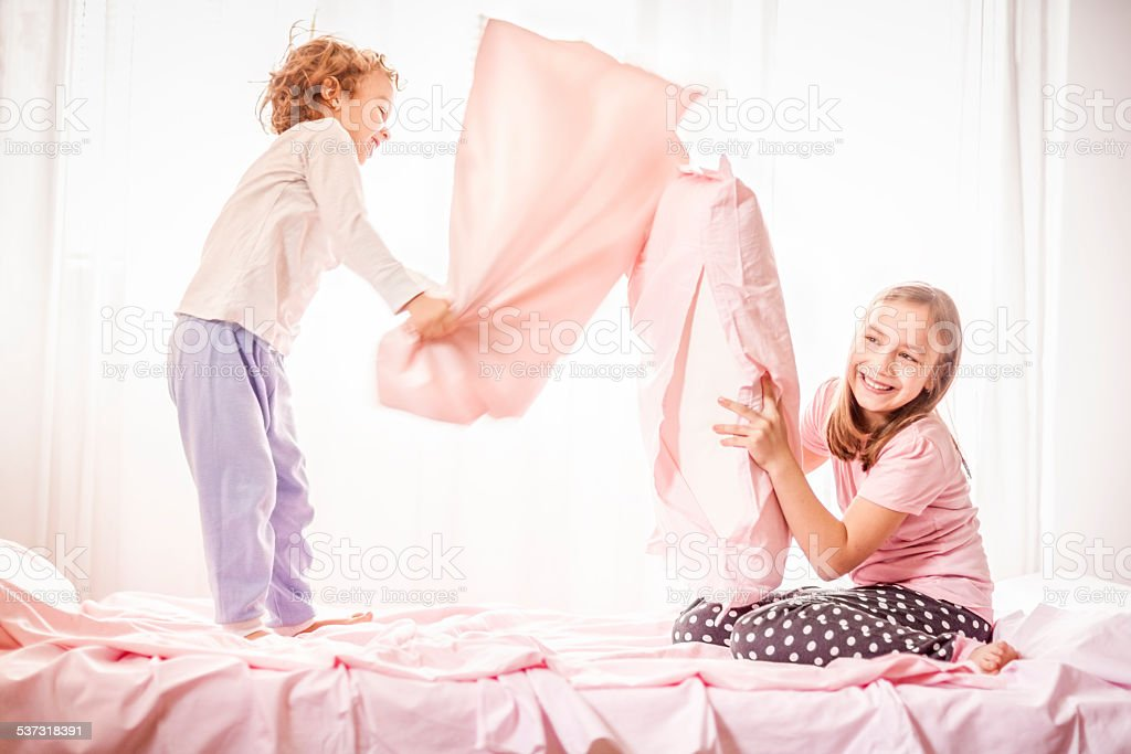 Happy children in a pillow fight stock photo