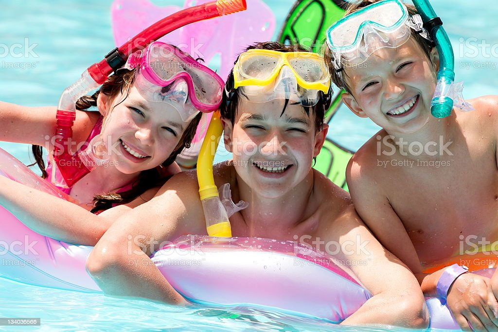 Happy children in pool royalty-free stock photo