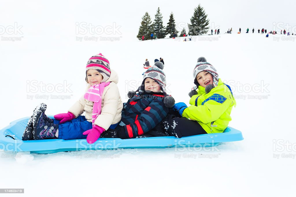 Happy children on a sled royalty-free stock photo