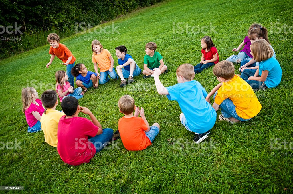 Happy Children Playing Duc, Duck, Goose Outside royalty-free stock photo