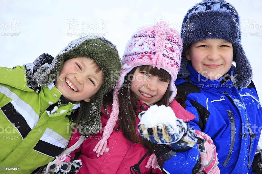Happy children playing in snow royalty-free stock photo