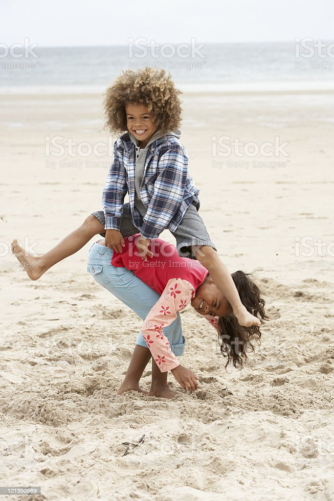Happy children playing on beach stock photo