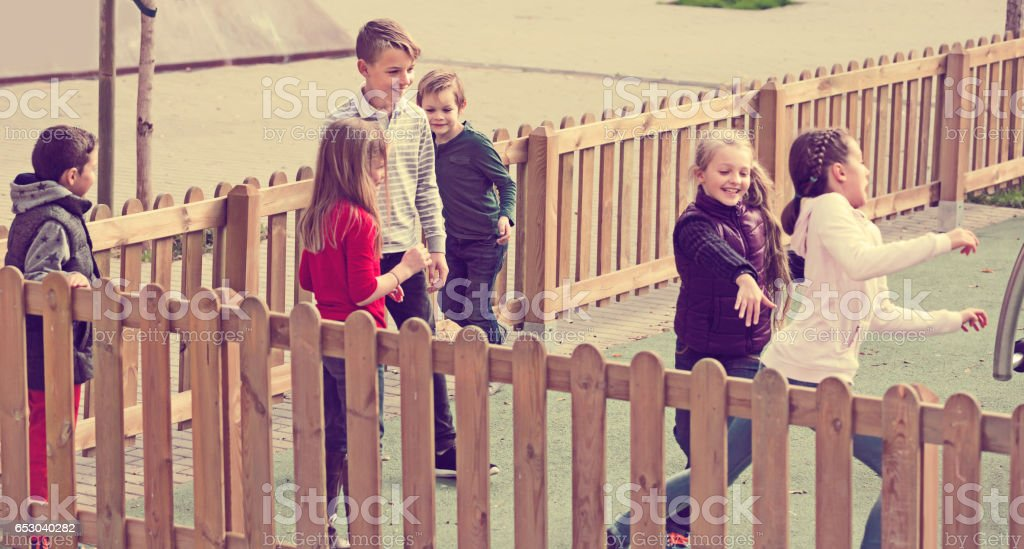 Happy children playing romp game Touch-last stock photo
