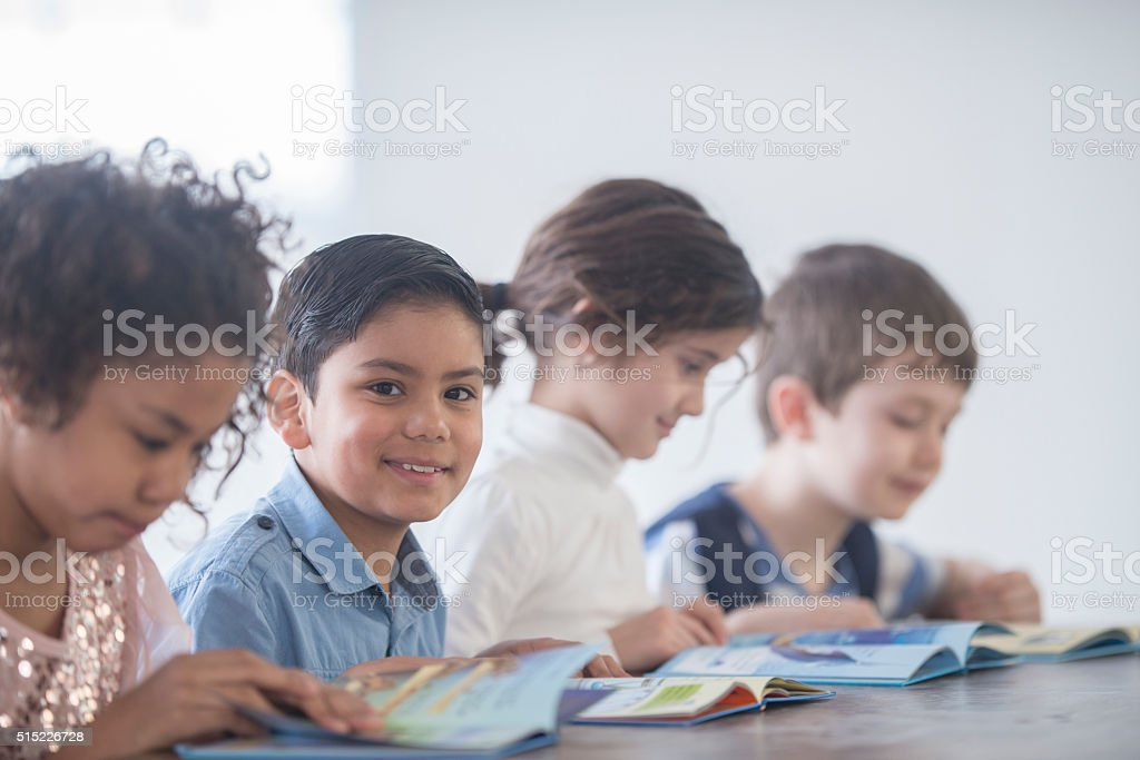 Happy Children Reading Books stock photo