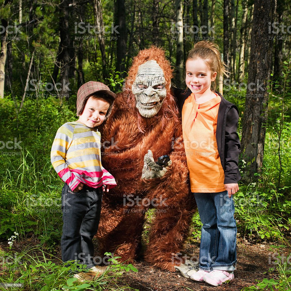 Happy Children together with Sasquatch in the Woods stock photo