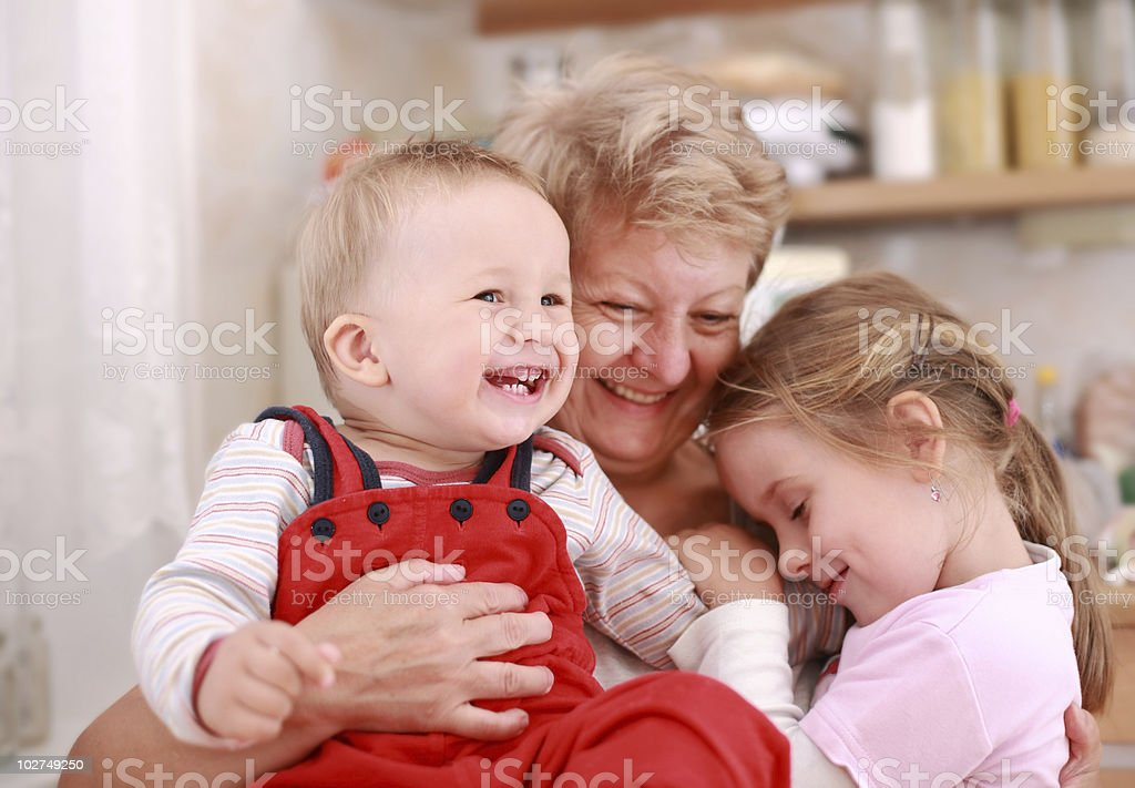Happy children with granny royalty-free stock photo