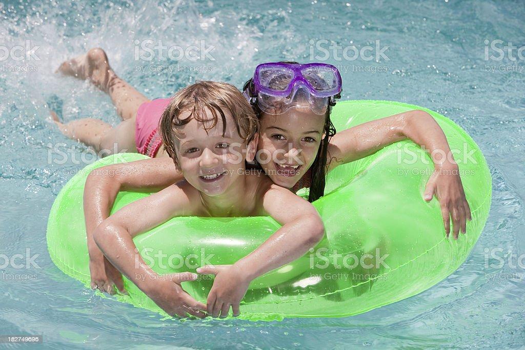 Happy Childrenin Swimming Pool royalty-free stock photo