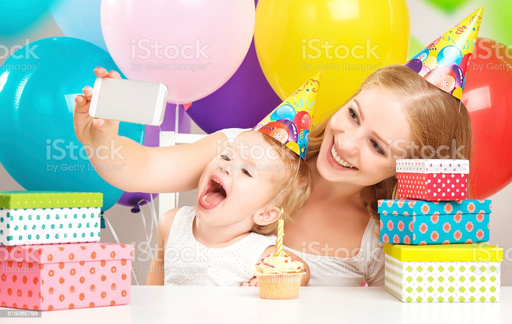 happy children's birthday. selfie. mother photographed  her daughter stock photo