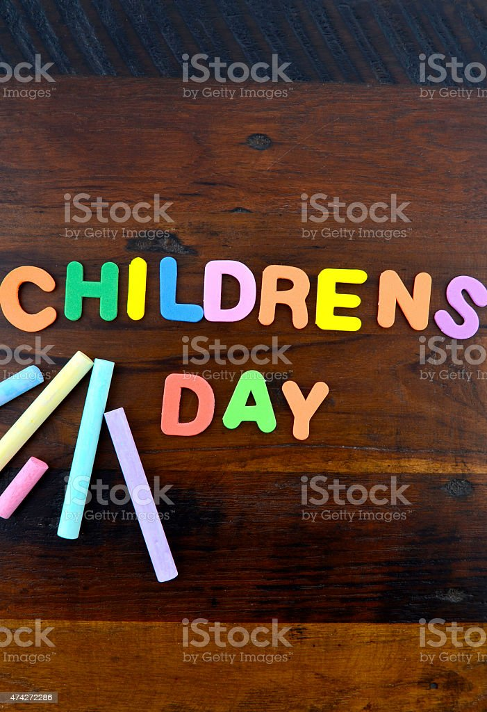 Happy Childrens Day concept with colorful play letters. stock photo