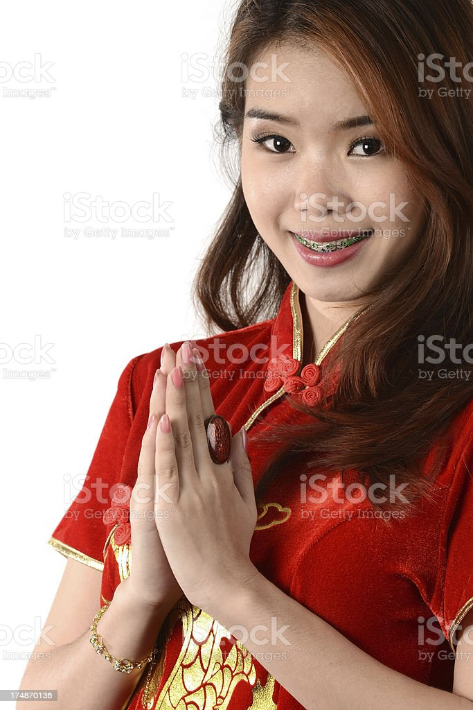 Happy Chinese new year by woman with Cheongsam dress royalty-free stock photo