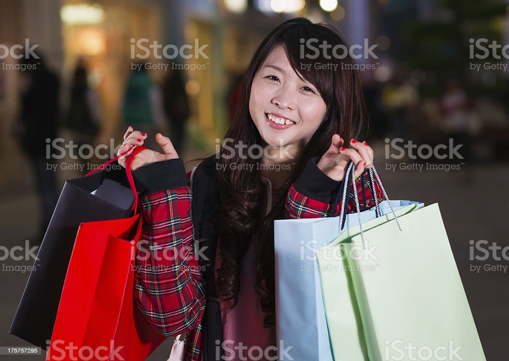 happy chinese woman with shopping bags royalty-free stock photo