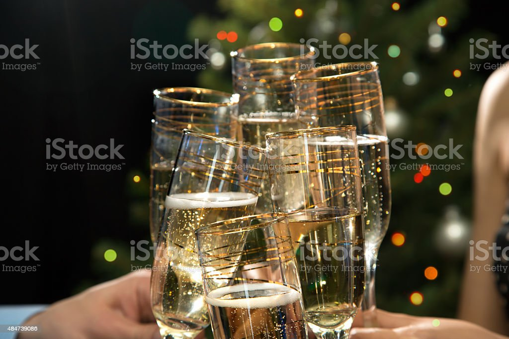Happy Christmas. People hands with crystal glasses/ stock photo