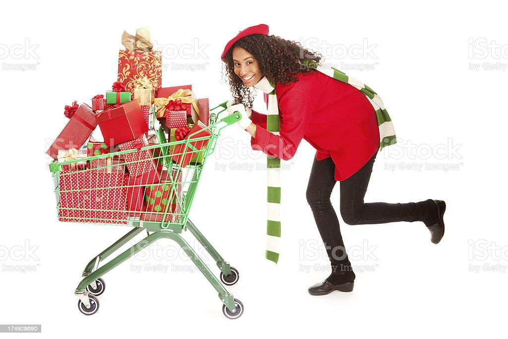 Happy Christmas Shopper with Shopping Cart on White Background stock photo