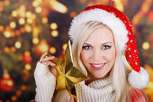 Happy christmas woman with golden star
